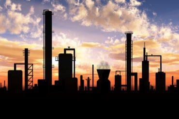 Oil refinery factory over sunrise